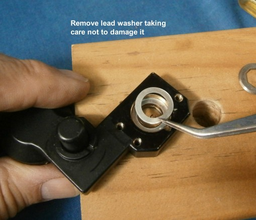 Figure 7: Remove another washer, carefully.